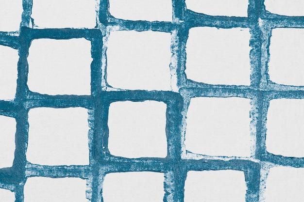 Handgemaakte prints met blauwe rasterpatroon als achtergrond