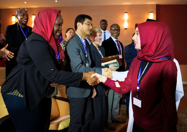 Hands shake agreement diversity conference partnership