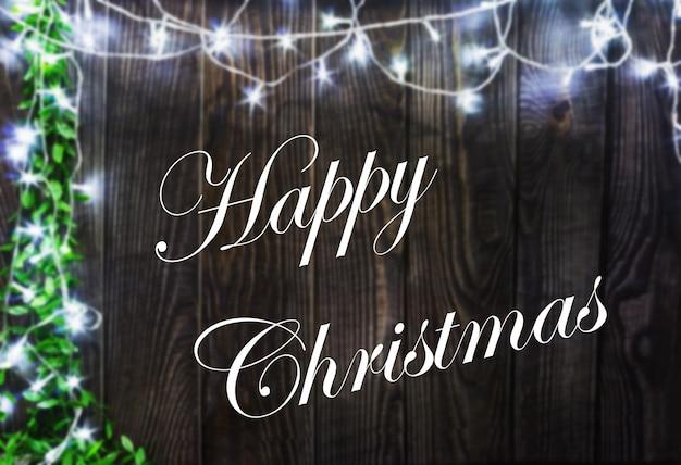 Happy christmas houten achtergrond met verlichting