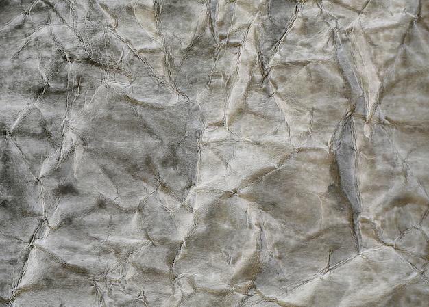 Harde grijze kaft papier verfrommeld