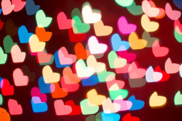 Hart bokeh achtergrond. valentijnsdag achtergrond