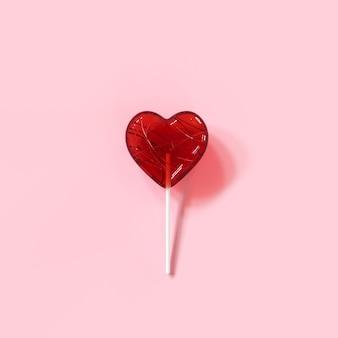 Hart van het barst het rode suikergoed op roze kleurenachtergrond. minimale valentijn conceptideeën. 3d render