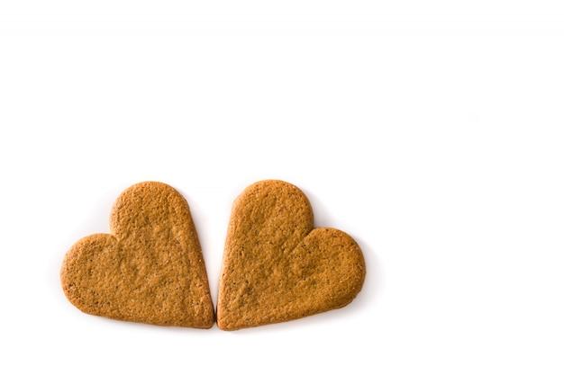 Hartvormig koekje dat op het concept van de dag en het moederdag van witte achtergrondvalentine wordt geïsoleerd.
