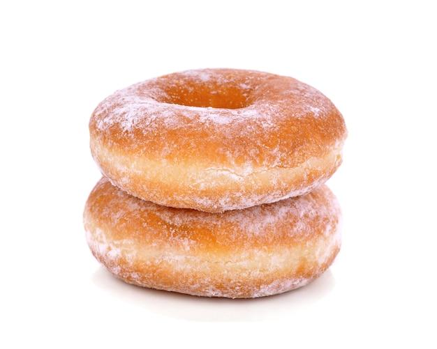 Heerlijke donuts die op een wit worden geïsoleerd