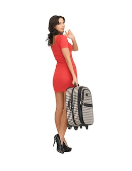Helder beeld van ongelukkige vrouw met koffer zwaaiende hand