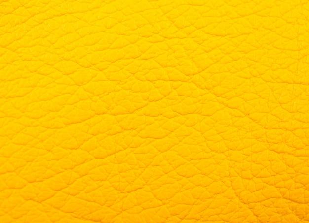 Helder geel leer als achtergrond van de leertextuur