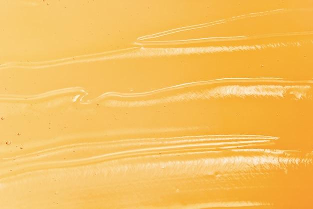 Helder oranje cosmetische gel textuur