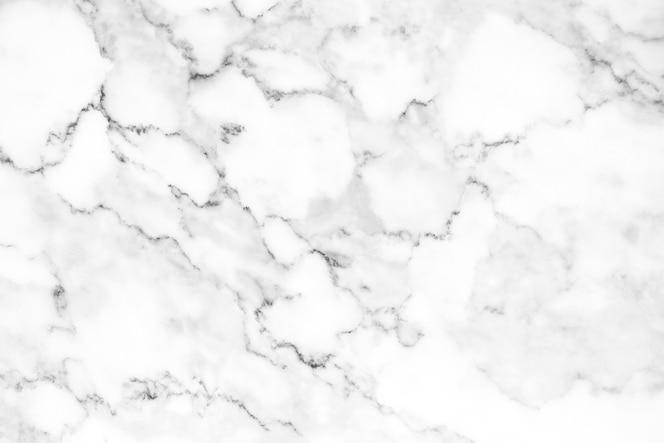 Helder wit natuurlijk marmeren textuurpatroon voor luxueuze achtergrond of huid.