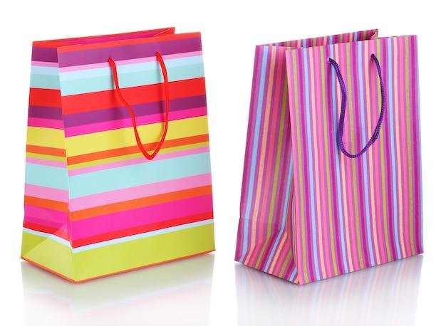 Heldere geschenkzakken geïsoleerd op wit