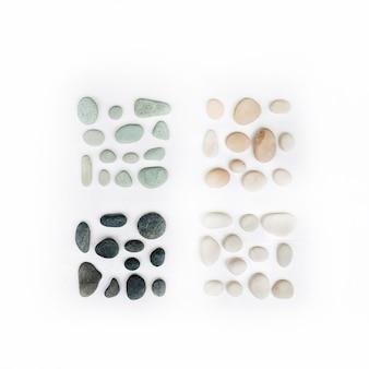 Heldere kleurrijke pastel stenen collectie. mint, roze, beige en grijze stenen op wit