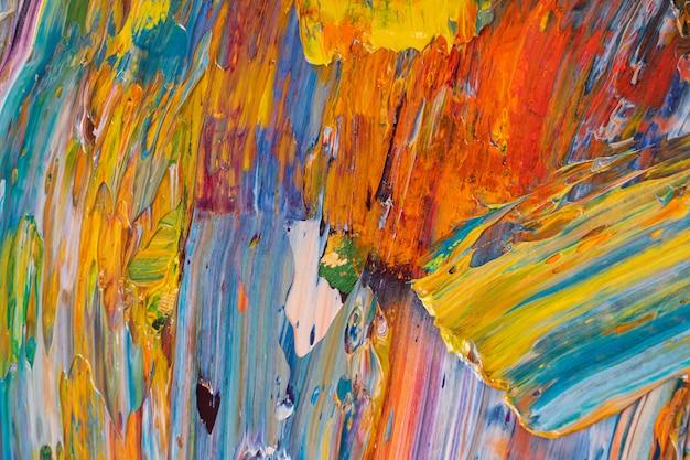 Heldere, sappige, veelkleurige abstractie van hun menging van olieverven op een paletclose-up.