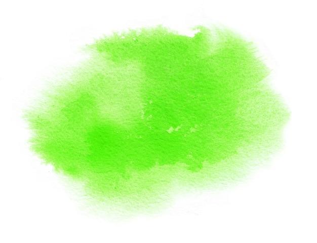 Heldergroene aquarel vlek met aquarel penseelstreek op wit papier achtergrond voor lente ontwerp