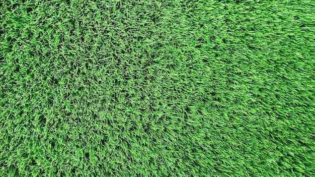 Heldergroene natuurlijke achtergrond. kunstgras close-up.