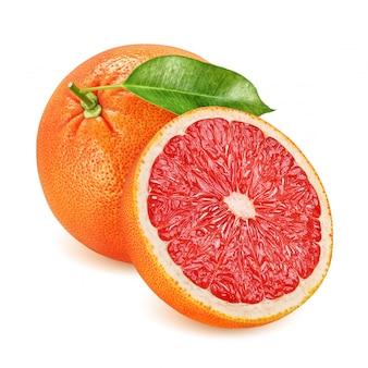 Hele en halve grapefruit met blad