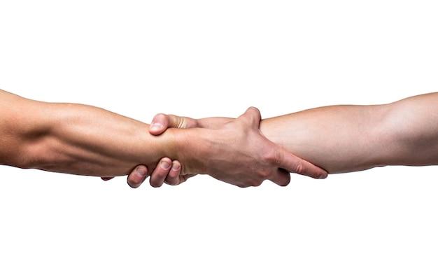 Helpende hand concept en internationale dag van vrede, ondersteuning. detailopname. helpende hand uitgestrekte, geïsoleerde arm, redding. sluit omhoog hulphand. twee handen, helpende arm van een vriend, teamwork.