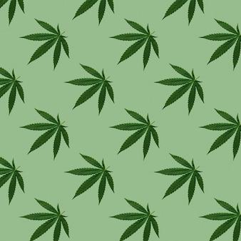 Hennep of cannabis laat naadloos patroon achter. close up van verse cannabisbladeren op groene achtergrond