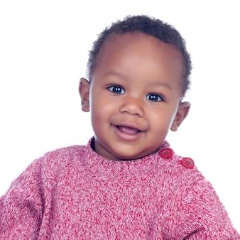 Het aanbiddelijke afrikaanse baby glimlachen