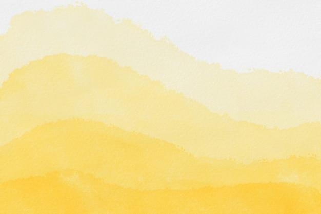 Het abstracte kunst achtergrond lichtgele en gouden kleurenwaterverf schilderen