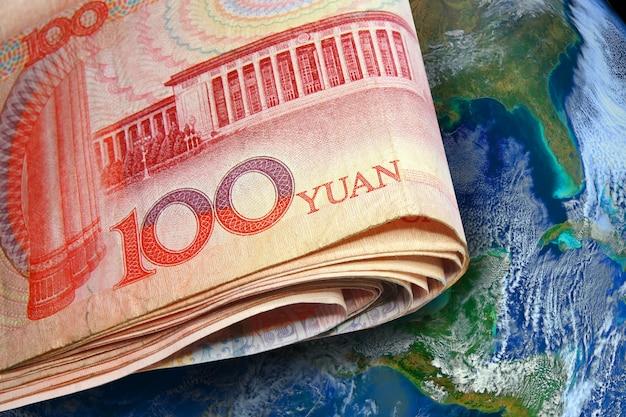 Het bankbiljet van china met planeetwereld