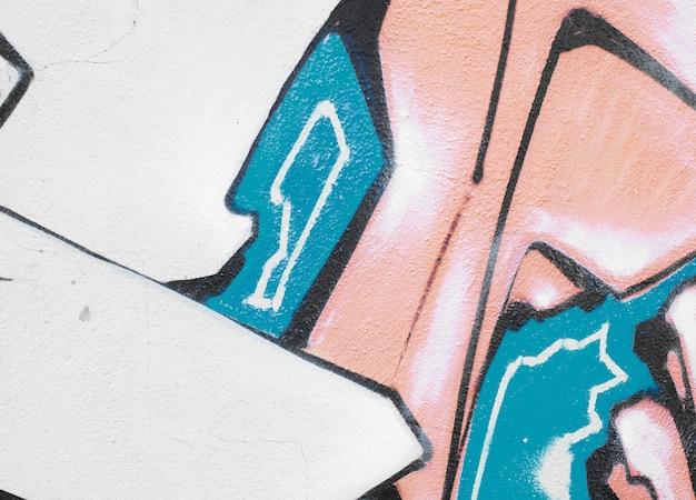 Het behangtextuur of achtergrond van het graffitidetail