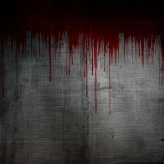 Het bloed ploetert en druipt op de achtergrond van het grungemetaal