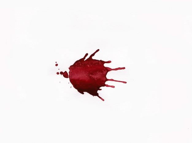 Het bloed ploetert op witte achtergrond