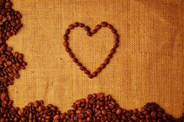 Het boonhart van de koffie bij het ontslaan achtergrond