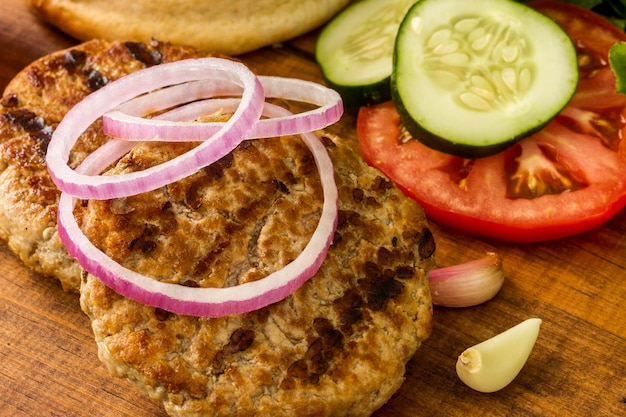 Het close-up van hamburgeringrediënten