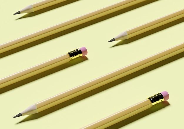 Het concept potloden met een gom ligt op geel