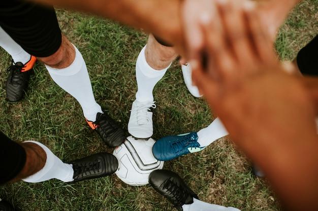 Het concept van de het teamgeest van voetbalsters