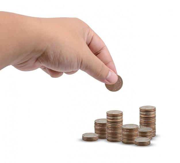 Het concept van het besparingsgeld vooraf ingesteld door de mannelijke van het het geldmuntstuk van de handholding de stapel groeiende zaken