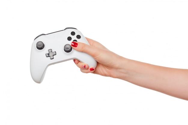 Het controlemechanisme van de videogameconsole in gamerhanden die op wit worden geïsoleerd