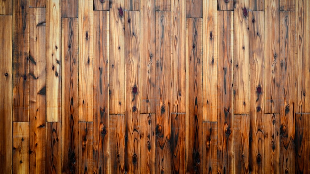Het donkere bruine houten detail van de paneelmuur als achtergrond