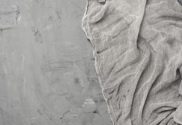 Het gaashanddoek van de linnenkeuken op grijze cementachtergrond, exemplaarruimte