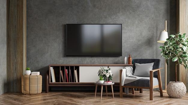 Het interieur van de woonkamer heeft een tv-kast en een fauteuil in een cementkamer met een betonnen muur. 3d-rendering
