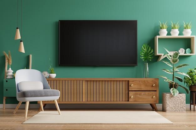 Het interieur van de woonkamer heeft een tv-kast en een leren fauteuil met groene muur. 3d-rendering