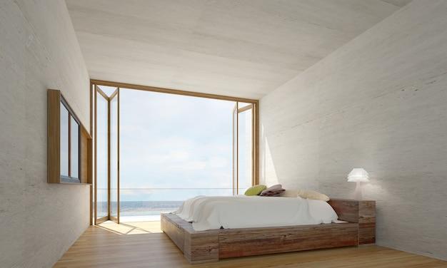 Het interieur van slaapkamer en betonnen muur textuur patroon achtergrond en uitzicht op zee