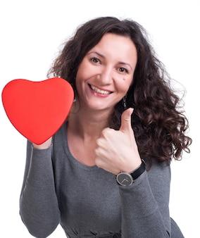 Het krullende hart van de vrouwenholding en ja teken op een witte achtergrond tonen
