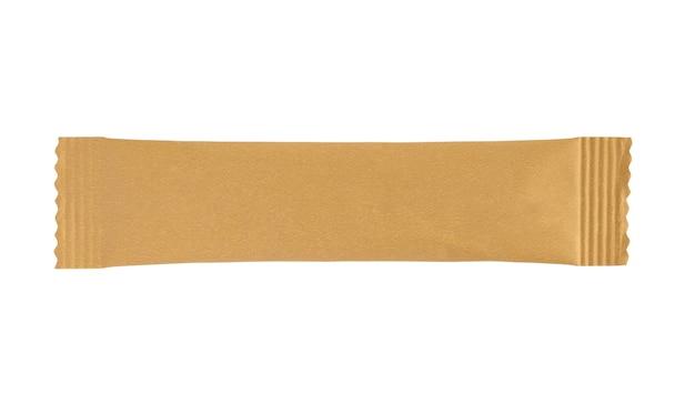 Het lege bruine pakket van het stoksachet dat op witte achtergrond wordt geïsoleerd