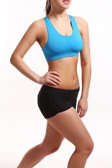 Het lichaam van de vrouw in een fitness slijtage