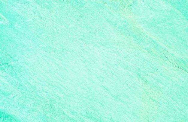 Het marmeren patroon van de close-upoppervlakte bij de groene marmeren geweven achtergrond van de steenmuur