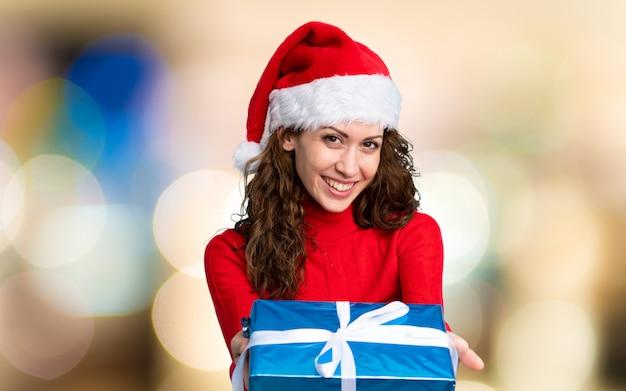 Het meisje met kerstmishoed ongericht achtergrond