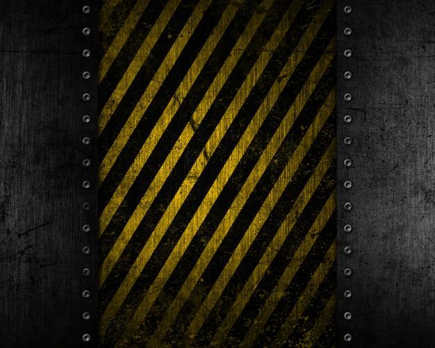 Het metaalachtergrond van grunge met gele en zwarte verontruste textuur