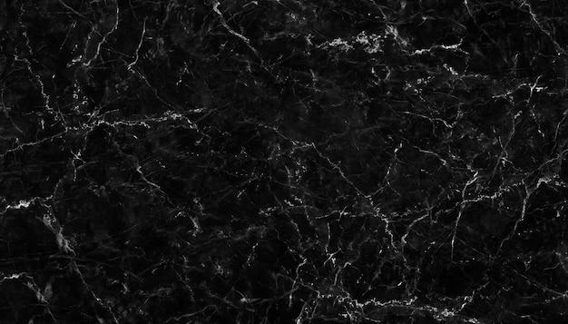 Het natuurlijke patroon van zwart marmer voor de luxe achtergrond van het huidtegelbehang