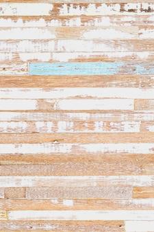 Het oppervlak van verweerd geverfd hout