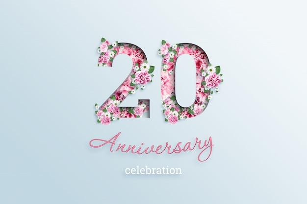 Het opschrift 20 nummer en de verjaardag viering textis bloemen, op een licht
