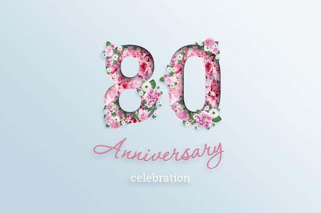 Het opschrift 80 nummer en de tekst van het jubileum vieren bloemen, op een lichtje