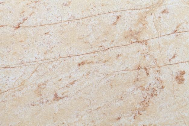 Het patroon van beige oude marmeren materiaal met gebarsten patroon