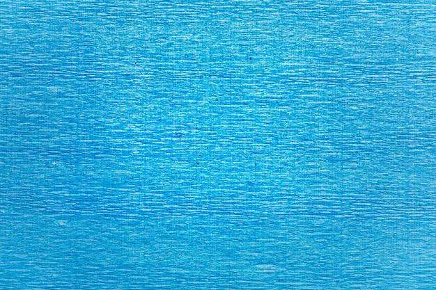 Het patroon van blauw gerimpeld golfpapier.