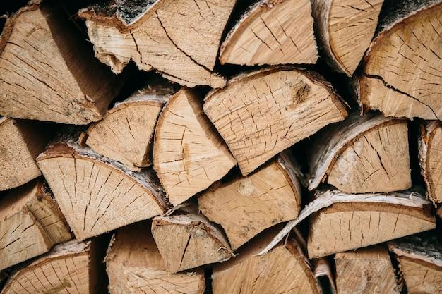 Het patroon van brandhout. achtergrond. groep van houten logboeken
